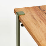 Reclaimed wood table top with green steel legs